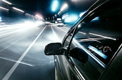Car driving fast Stock Photography