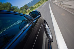 Car driving fast on a road Royalty Free Stock Photography