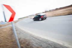Car driving fast through a sharp turn Stock Image