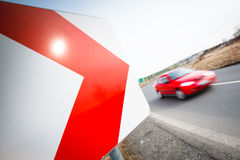 Car driving fast through a sharp turn. Traffic concept: car driving fast through a sharp turn (motion blur is used to convey movement Royalty Free Stock Photos