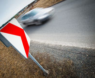 Car driving fast through a sharp turn. Traffic concept: car driving fast through a sharp turn (motion blur is used to convey movement Royalty Free Stock Image