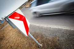 Car driving fast through a sharp turn Stock Photos