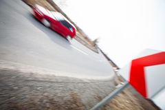 Car driving fast through a sharp turn. Traffic concept: car driving fast through a sharp turn (motion blur is used to convey movement Stock Images