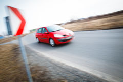 Car driving fast through a sharp turn Stock Images