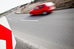 Car driving fast through a sharp turn Royalty Free Stock Images