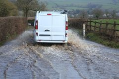 Car driving through a flooded road Royalty Free Stock Photography