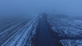 Car driving forward. Foggy weather stock footage
