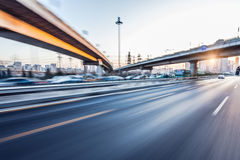 Car driving on freeway, motion blur royalty free stock photography
