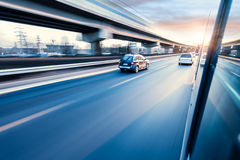 Car driving on freeway, motion blur. Car driving on freeway at sunset, motion blur Royalty Free Stock Images