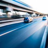 Car driving on freeway, motion blur Stock Images