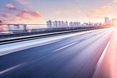 Car driving on freeway at sunset, motion blur Royalty Free Stock Photo