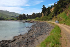 Car driving on gravel road Royalty Free Stock Images