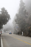 Car driving in heavy fog Royalty Free Stock Photography