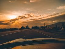 Car driving on the highway. Road view from inside car behind console. First-person photo. travel background royalty free stock image