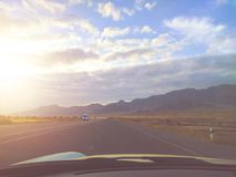 Road trip. Car driving on the highway. First-person photo stock photography
