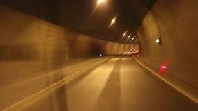 Car driving highway and through tunnel, alpine mountain. Car driving highway and through tunnel stock footage