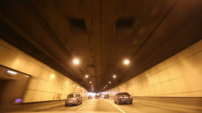Car driving on highway tunnel, Moscow, Russia.  stock video footage
