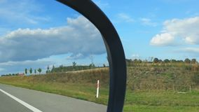 Car driving on highway, view from passenger seat. Fields and forest on roadside. Stock footage stock video