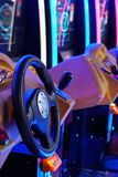 Car driving machines at arcade games in the entertainment zone in shopping center royalty free stock images