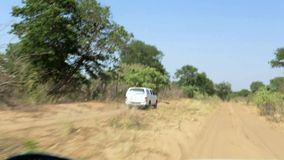 Car driving on main road road to Okavango stock video footage