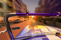 Car Driving in Milano. American muscle car speeding through the streets of milano at dawn Royalty Free Stock Photos