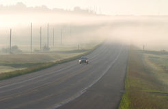 Car driving through the  mist Royalty Free Stock Images