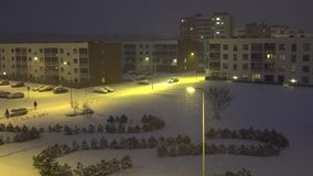 Car driving between modern flat apartment houses district in winter. 4K stock footage