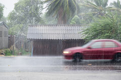 Car driving motion through gale rain on front wooden house Royalty Free Stock Photos