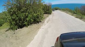 Car driving on mountain road stock video footage