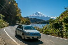 Car driving near Mt Fuji in Japan with motion blur stock photo