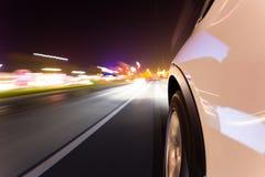Car driving at night city Royalty Free Stock Photos