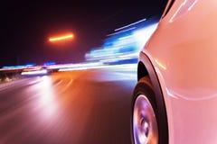Car driving at night city Stock Photo