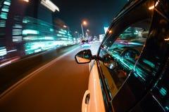 Car driving at night city Royalty Free Stock Photography