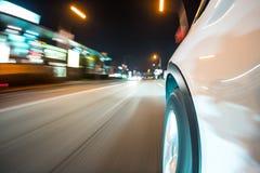 Car driving at night city Royalty Free Stock Photo