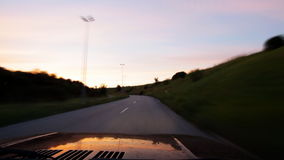 Car driving at night - timelapse. HD 1080 timelapse : Man driving car at sunset, taking left turn stock video footage