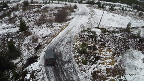 Car driving in northern town, aerial view stock video footage