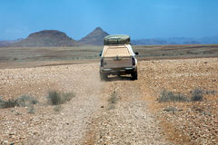 Car Driving On A Gravel Road Stock Image