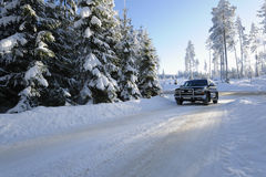 Car Driving On Snowy Roads Royalty Free Stock Image