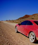 Car driving through outback Royalty Free Stock Image