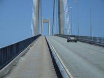 Car driving over a big bridge Stock Photo