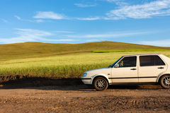 Car driving on the prairie path Stock Photo