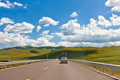 Car driving on the prairie path Stock Photography