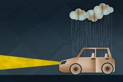 Car driving in rain between dark night Royalty Free Stock Photos
