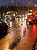 Car driving in rainy evening Stock Photo