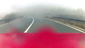 Car driving through the rainy weather conditions stock video footage