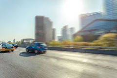 Car driving on road, motion blur Stock Photography