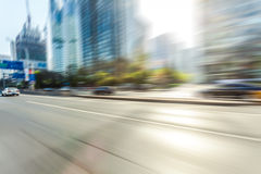 Car driving on road, motion blur Stock Photos