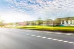 Car driving on road, motion blur Royalty Free Stock Photos