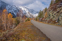 Car driving road mountains snow autumn Stock Images