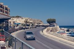 Car driving on a road in Rethymno, Crete Greece stock photos